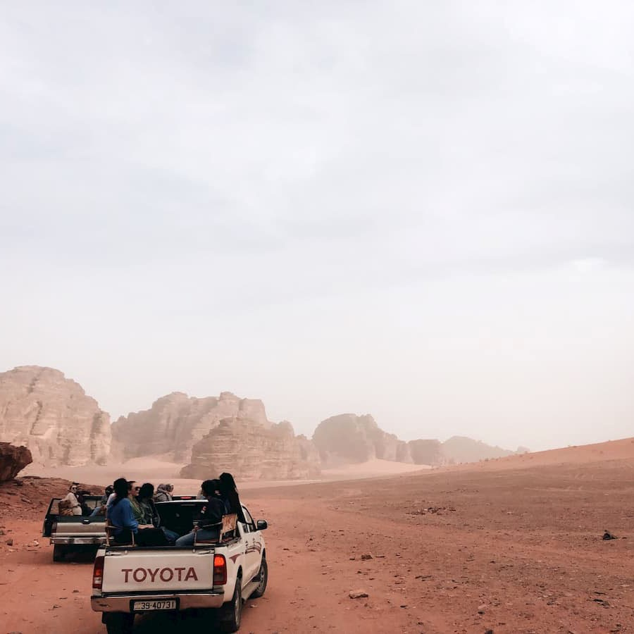 Maddy Van Husen '20 rides through a little sand storm in Wadi Rum, Jordan. One of her favorite memories in Jordan is watching the colors of the rocks and sand change during sunrise.