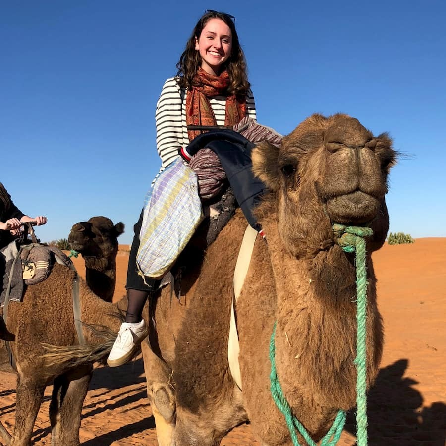 Sarah Engleberg-Nolan '20 rides a camel through the Sahara Desert near Merzouga, Morocco, about 30 miles west of the Algerian border.