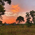 Sun sets over a village in Siaya County, in southwestern Kenya near the Ugandan Border, in a photo taken by Victoria Pouille '20, who lived there (and in the Ivory Coast) for several weeks in August 2019 during a research and service trip focusing on women's reproductive health.
