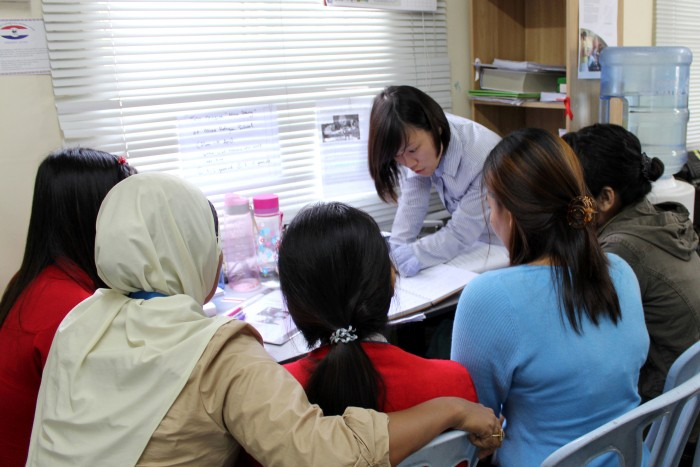 Volunteers joining the Refugee Women's Protection Corps are trained and coached by Jackie Loo