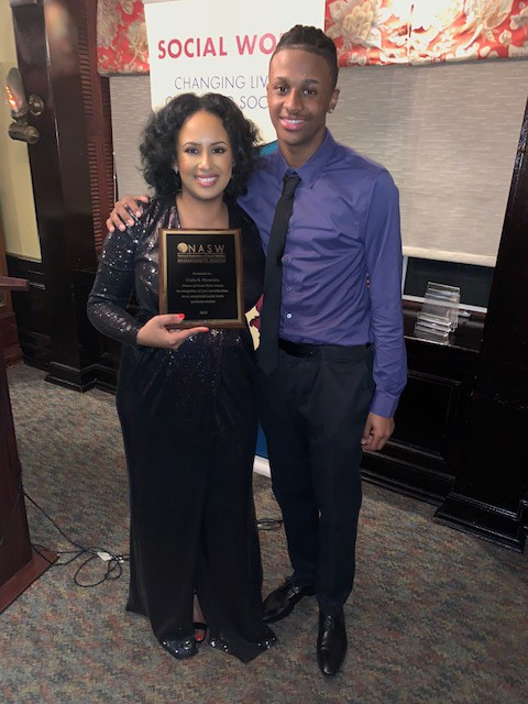 Carla Monteiro (pictured with her son) received the 2019 Future of Social Work Award from NASW.