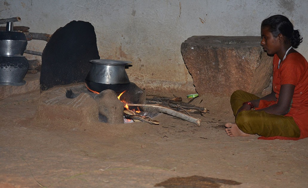 A woman uses a traditional cookstove in a village in Andhra Pradesh, India.