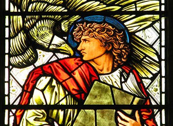 St. John and eagle in stained glass