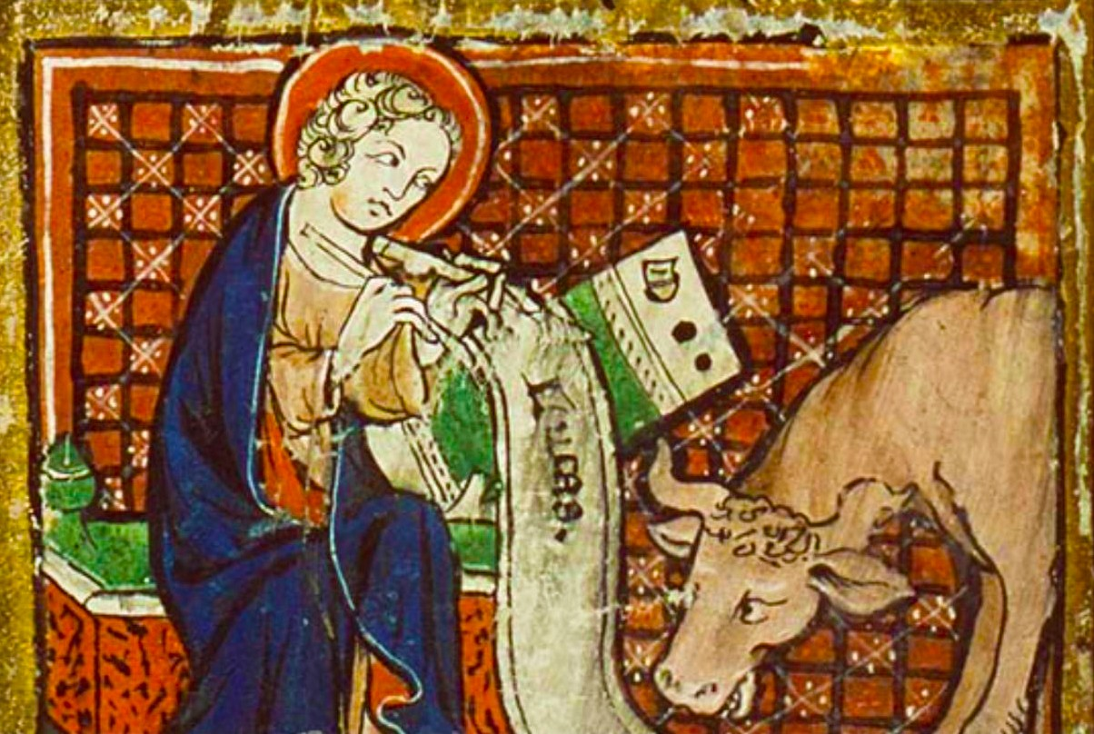 St. Luke writing with his bull from an illuminated manuscript
