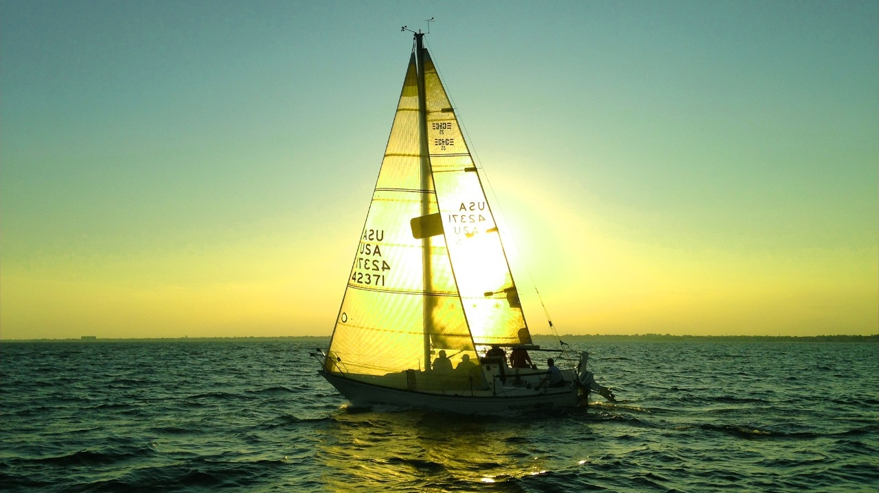 Sailboat with the sun on the horizon