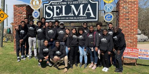 Group photo of students in front of the Selma sign
