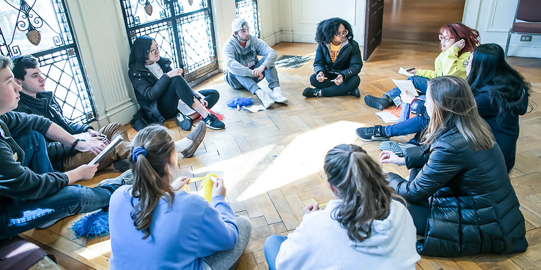 Students sit in a circle during 2018 'Envision' program