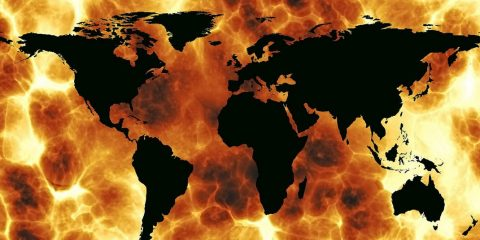 Image showing map of the world amid flames