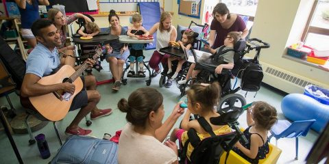 A group of students and teachers in a Campus School classroom