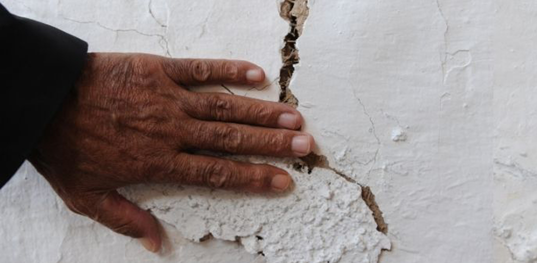 hand on a wall crack