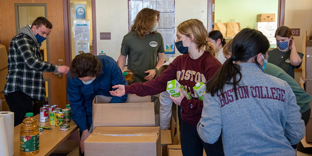 A group of students packing boxes