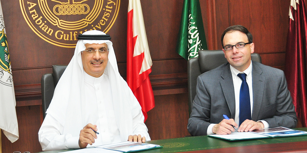 GLI Director Robert Mauro and Dr. Khalid Al-Ohaly President of the Arabian Gulf University at the signing.