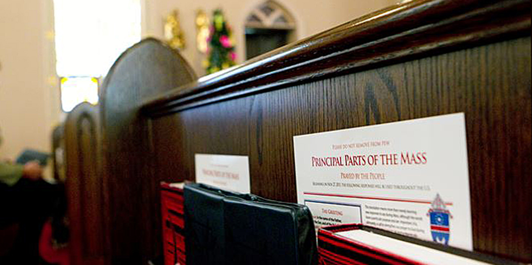 A guide to the new wording in the Mass is pictured in a pew.  (CNS photo/Nancy Phelan Wiechec)