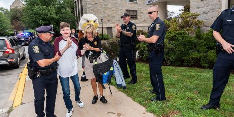 BCPD officers with a Campus School student