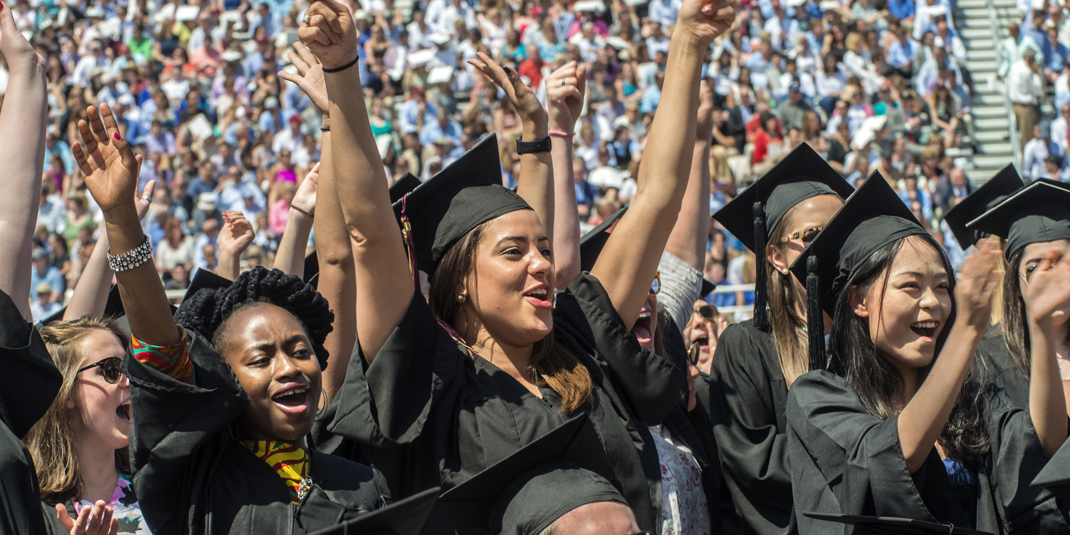 Graduates celebrate during Commencement