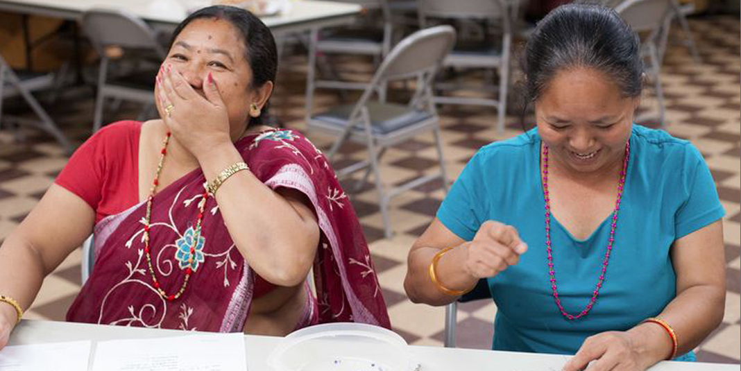 A beading session at Loom Chicago. Photo courtesy of Catholic Charities of the Archdiocese of Chicago