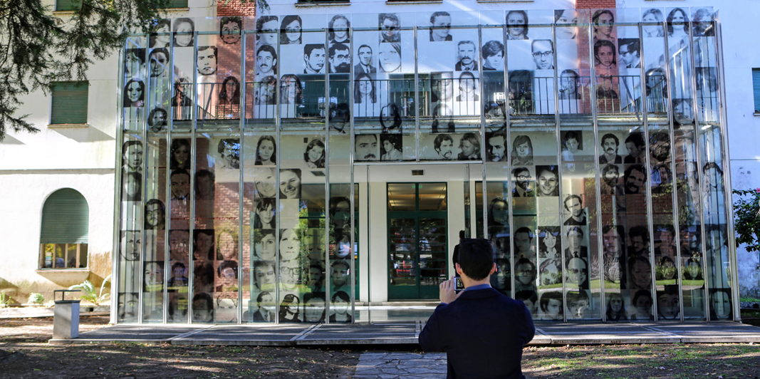 Assistant Professor of the Practice of Philosophy David Storey takes a photo of the entrance to a memorial museum located in buildings that once housed a detention and torture center on the site of Argentina's former naval academy.