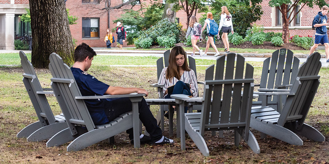 Students sitting in Adirondack chairs