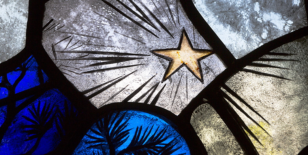Star detail from the Epic Poetry stained glass window in the Thompson Room of Burns Library.