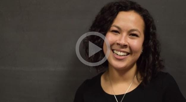 still from a video featuring an alum (Alejandra Trejo '15) speaking against a black background