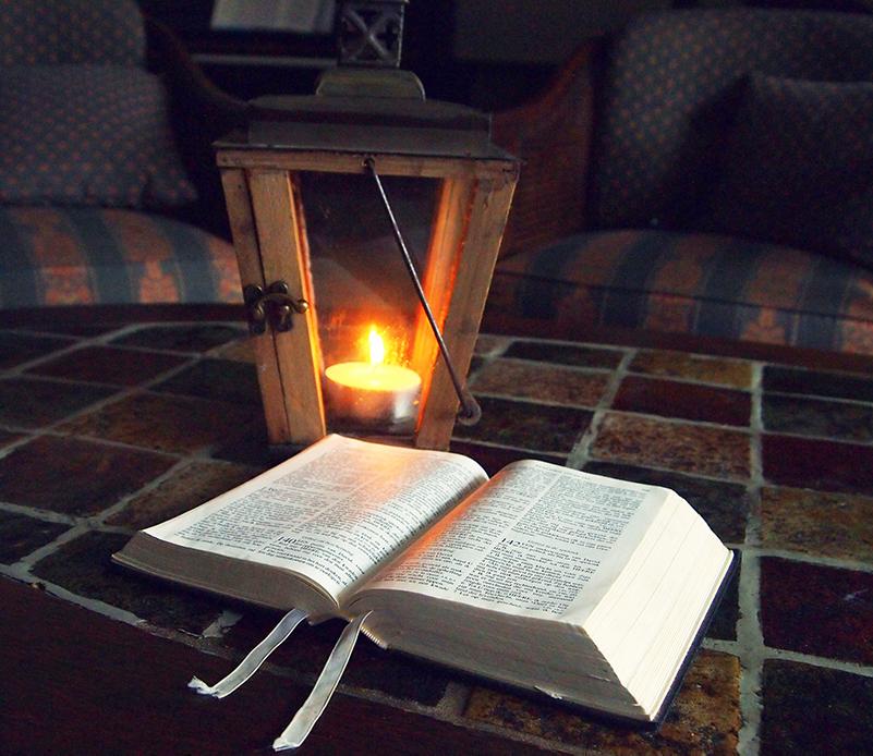 A lantern with a Bible