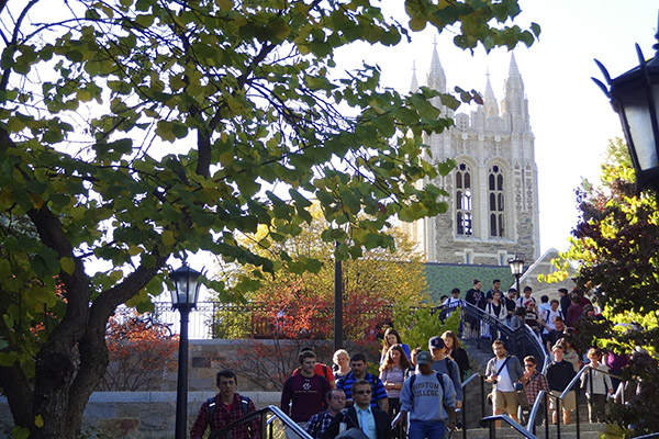 Students walk down the Higgins stairs