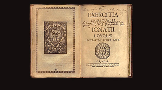 "photo of open book, ""Exercitia Spiritualia Ignatii Loyole"""