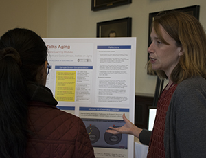 Carrie Johnson presenting a poster