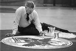 In This Photograph Dated January 12 1977 Longtime Athletic Director William J Flynn 1939 MEd1940 Paints The University Logo Which Includes An
