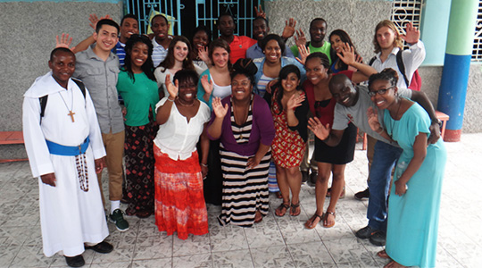group photo of Boston College students with Jamaican hosts