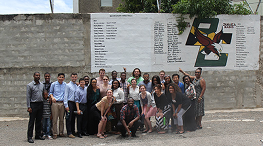 BC students in front of BC mural in Jamaica