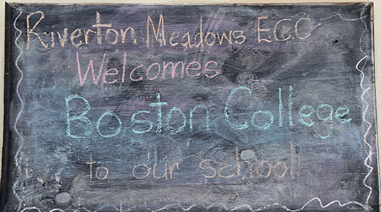 Chalkboard in Jamaican school welcoming Boston College