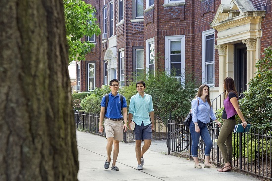 students walking near off campus apartment