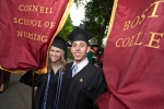 gradutes holding connell school banners