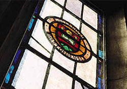 Stainglass window panel with the Boston College seal